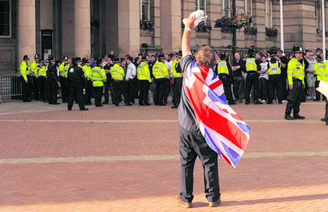An English Defence League (EDL) supporter taunts police. Image: Birmingham Mail